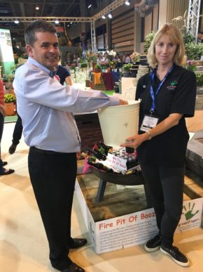 Woodlodge raises £1,000 for Greenfingers with fire pit raffle