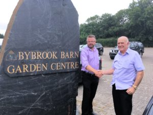 Nigel Long MD of Longacres Garden Centre and Terry Burch of Bybrook Barn shake hands on the completion of the acquisition