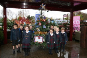 Squire's holding Christmas tree decoration school competition